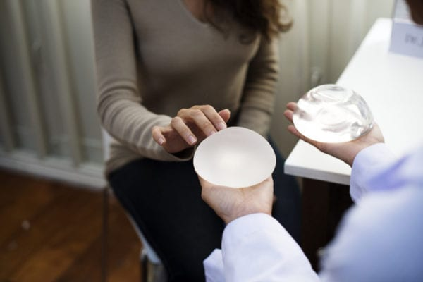 patient viewing two breast implants - Information on a Rare Breast Implant-Associated Cancer: BIA-ALCL